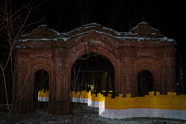 A special light painting tool displays radiation levels in real-time at the gates of a ruined church in Starye Bobovichi, Russia.  Here white light shows contamination levels up to 0.23uSv/h, while orange highlights elevated levels – from 0.50uSv/h to 0.85uSv/h around the gates.  30 years after the 1986 Chernobyl nuclear disaster, the schoolyard still contains areas of elevated radiation levels.